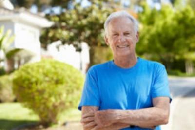 Older white man smiling outdoors.jpg