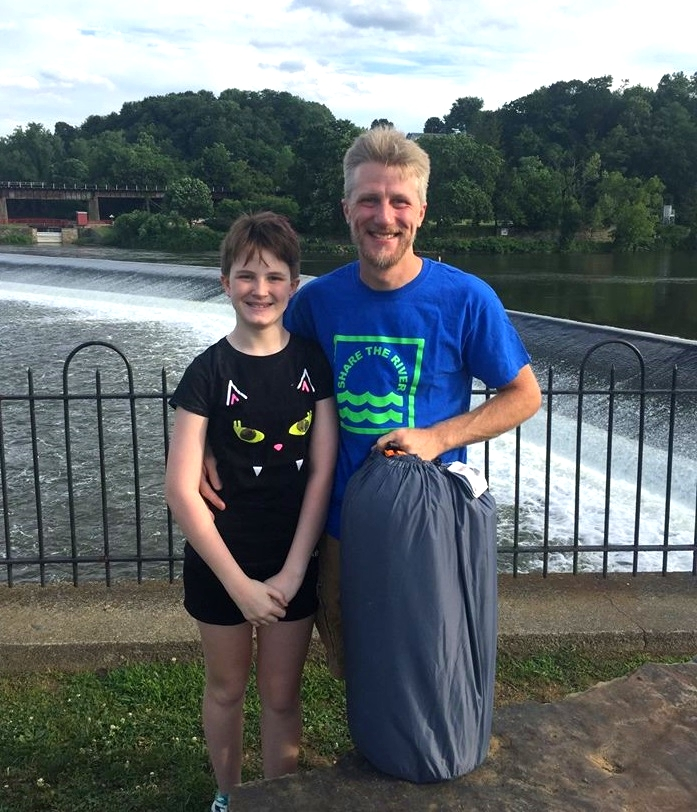 """Matt B. and Madi celebrating their win of the Delaware River Means """"Togetherness"""" contest in front of the Delaware River in Easton, PA."""