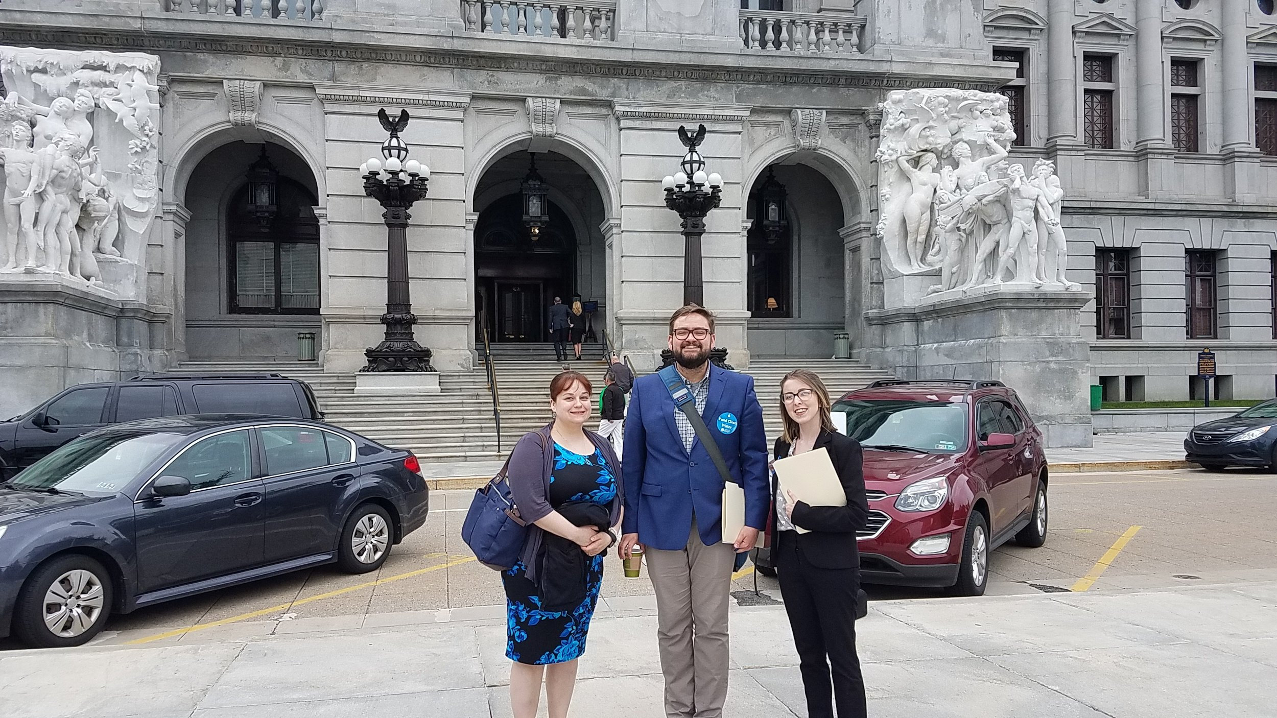 Emily of PennFuture, Kelly of CDRW, and Courtney of CDRW pose in front of the Harrisburg State House.