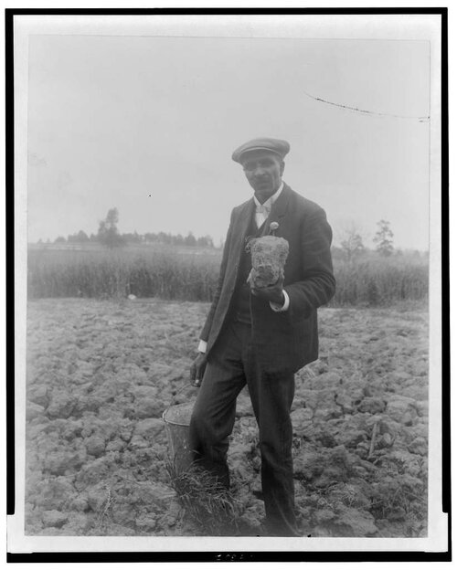 george-washington-carver-full-length-portrait-standing-in-field-probably-at-23056f-1024.jpg