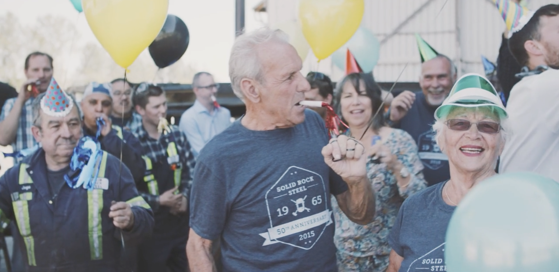 2015 - Solid Rock Steel founders Benny & Grace Steunenberg celebrate the company's 50th anniversary with the team.