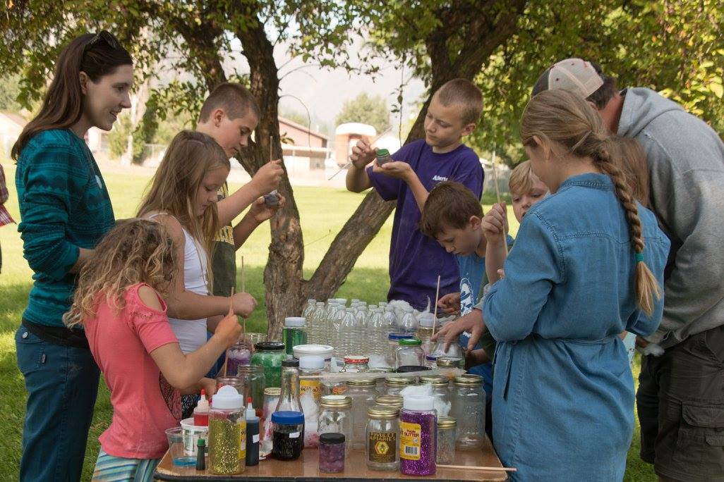 Making Galaxy bottles with glitter, cotton, and colored water at the Solar Eclipse Party, August 2017