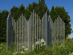 Chime fence to be placed on a corner of the tennis court