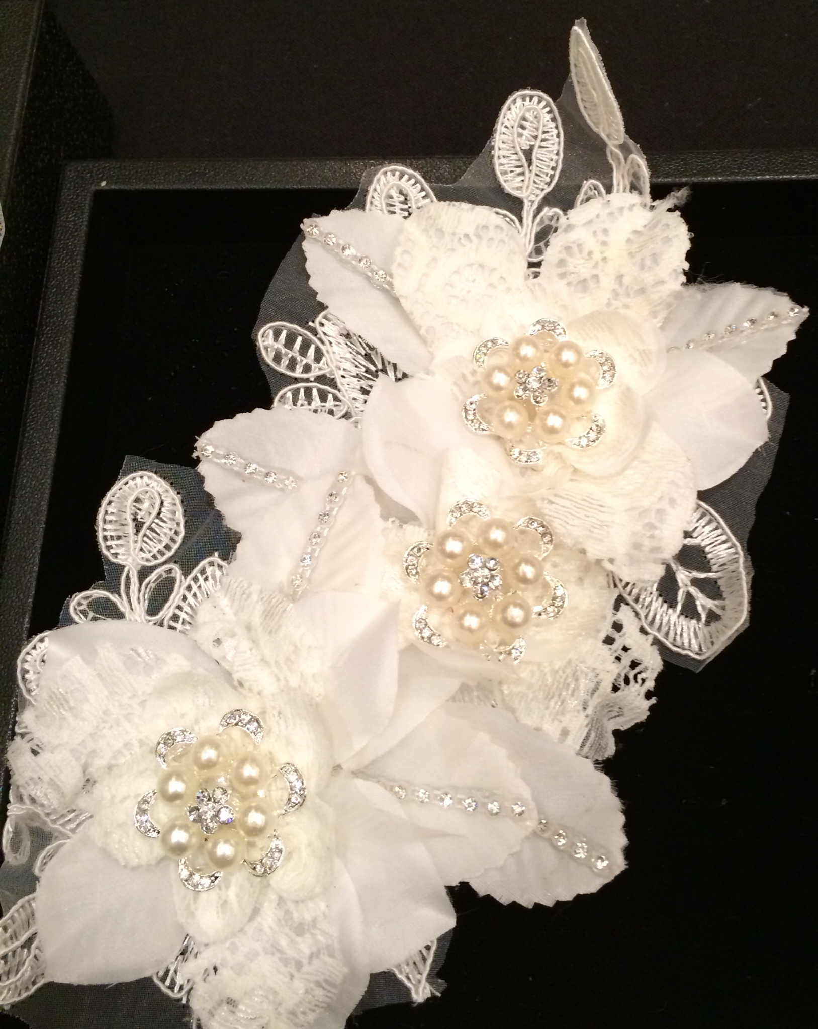 This is a beautiful headpiece with great detail. Sells for upward of $100 elsewhere. It's free at Teresa's for the bride.