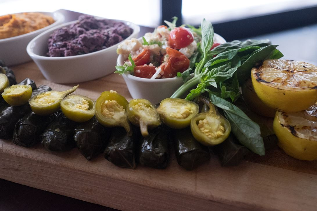 Vegetarians aren't the only ones raving about the Mediterranean Tasting at Scholars! It's served with Tomato Salad, Stuffed Grape Leaves, Marinated Cherry Tomatoes and Tapenade Trio.