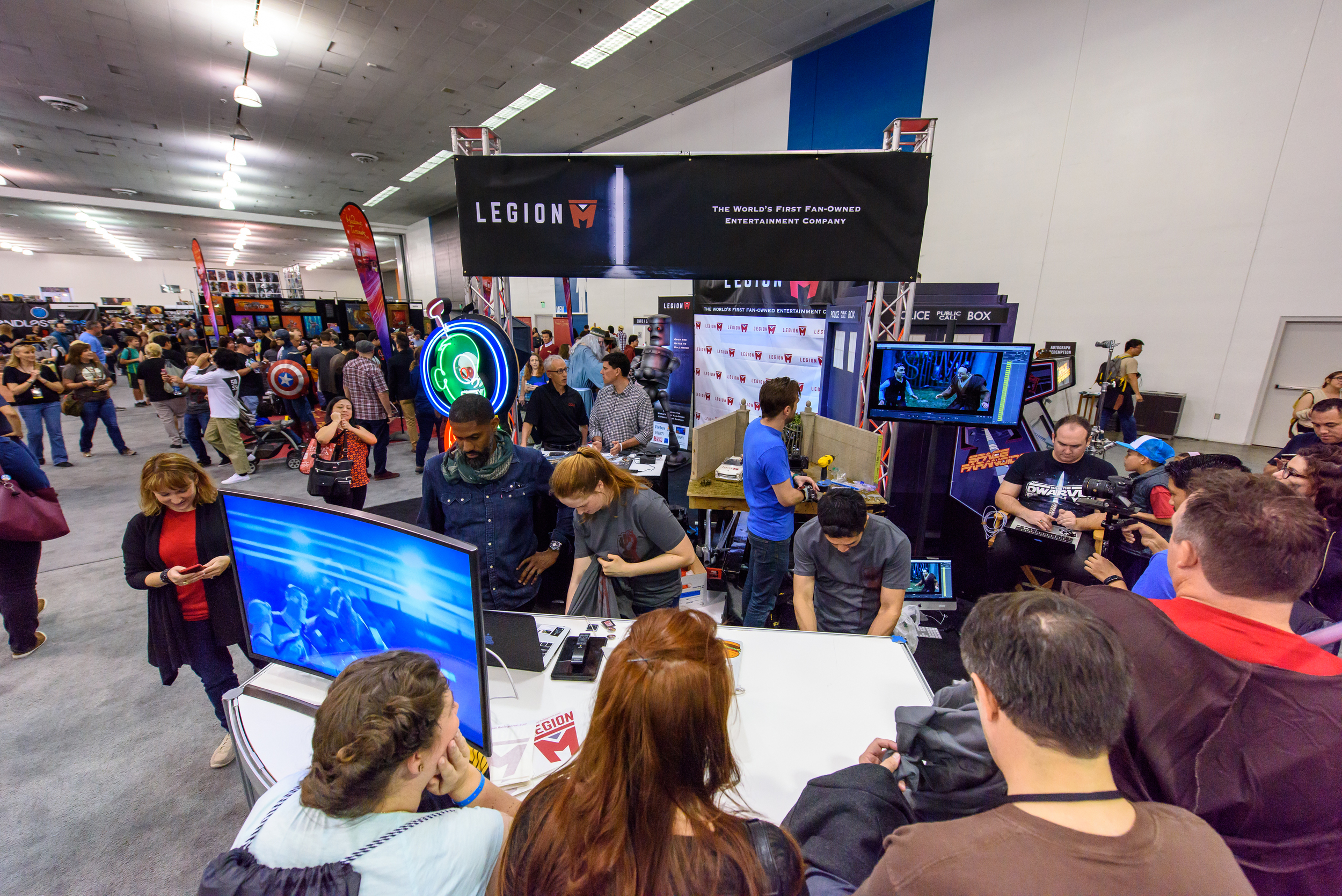 """The Legion M booth was located in the heart of the convention--right across from the time traveling DeLorean and the """"Back to the Future"""" cast reunion!"""