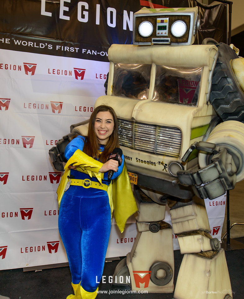 """What's that she's posing with? Oh, just a 9 foot tall winnebago transformer costume named """"Stoop Bot""""from Stoopid Buddy Stoodios. He spent the whole weekend hanging out at our booth."""