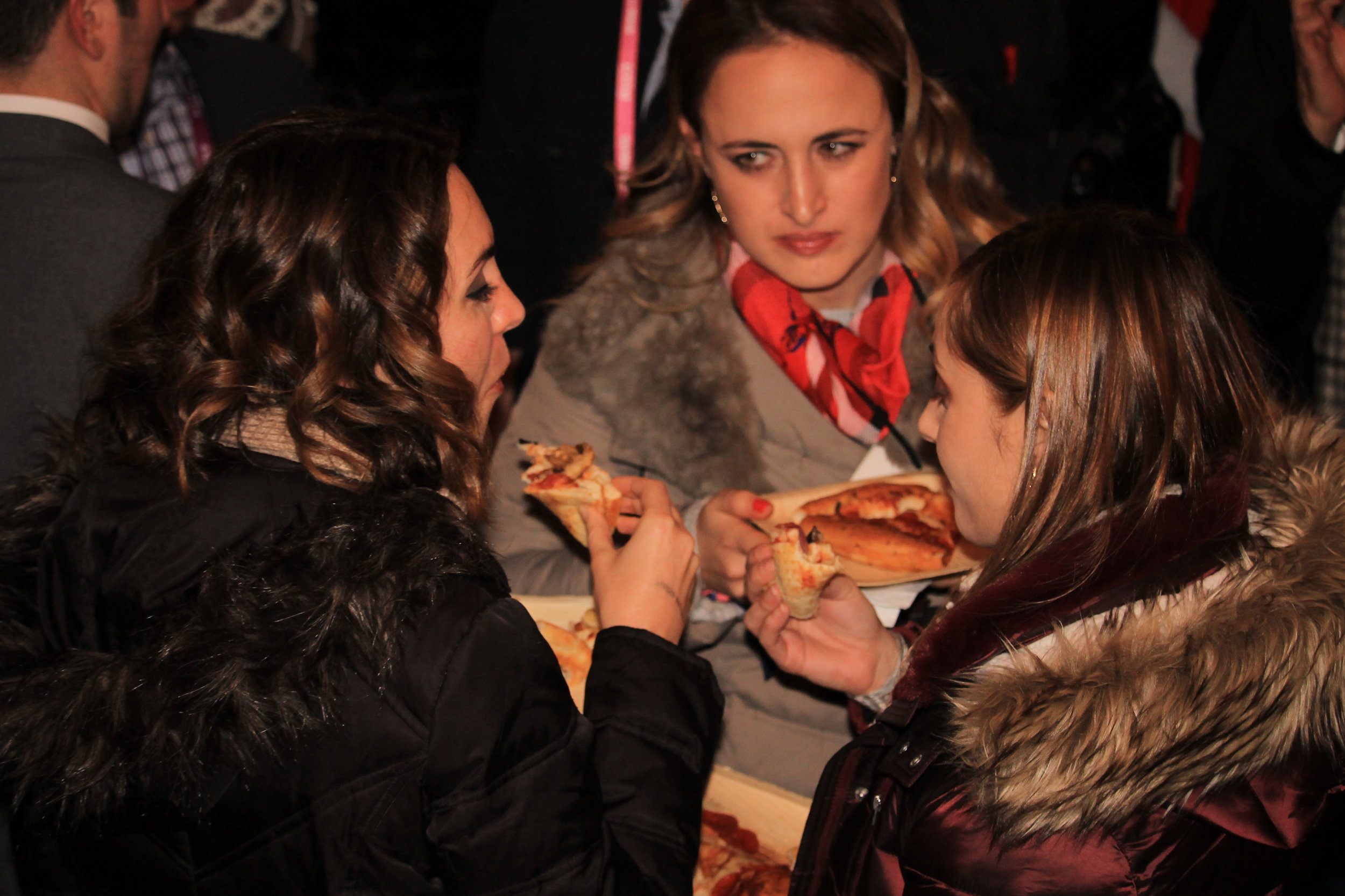 Folks came in from the bitter cold to enjoy a hot slice of pizza.