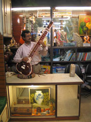 One of the Kumar bros. completing jawari work on a new sitar.