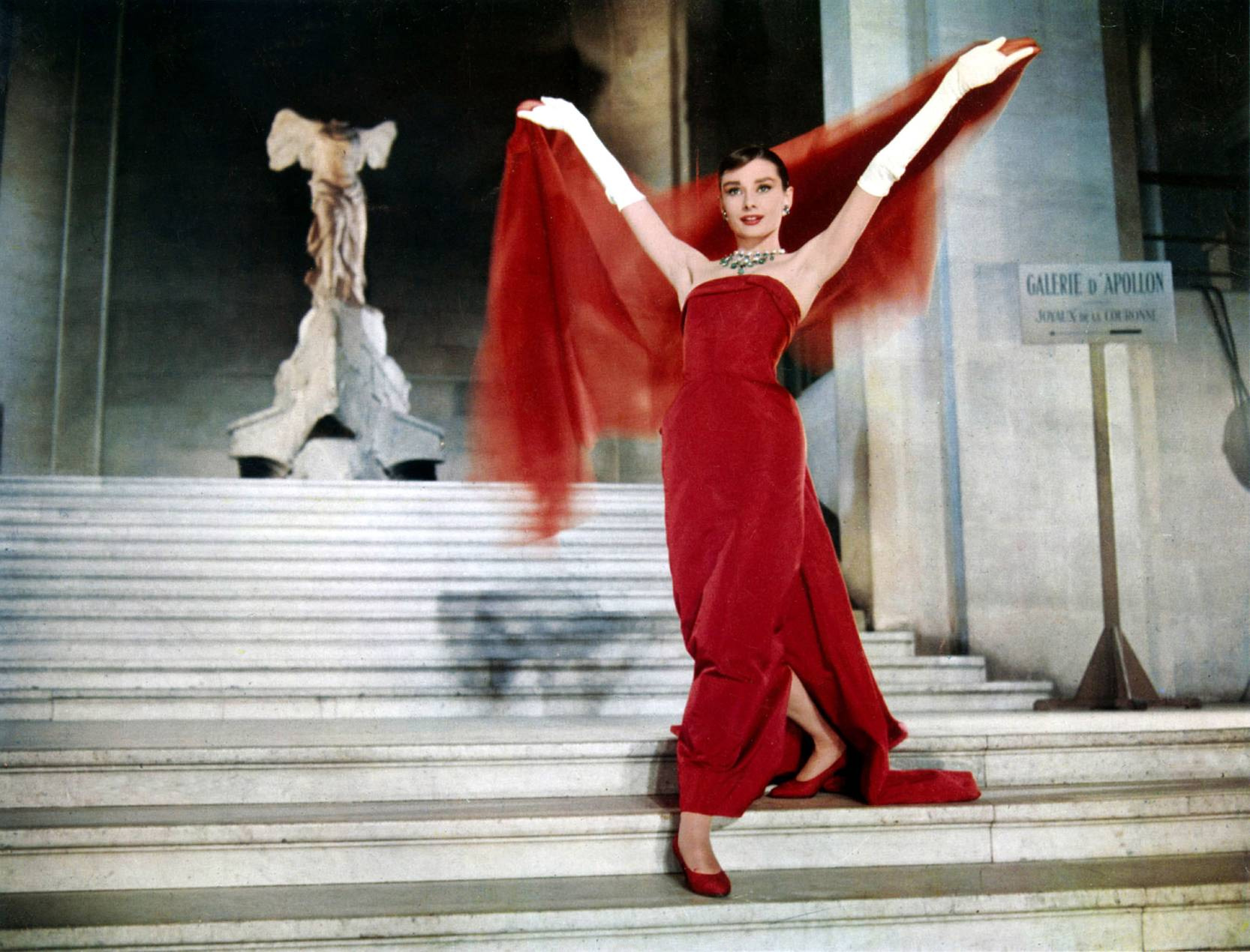 Audrey Hepburn walking down the stairs for a photo shoot in Funny Face