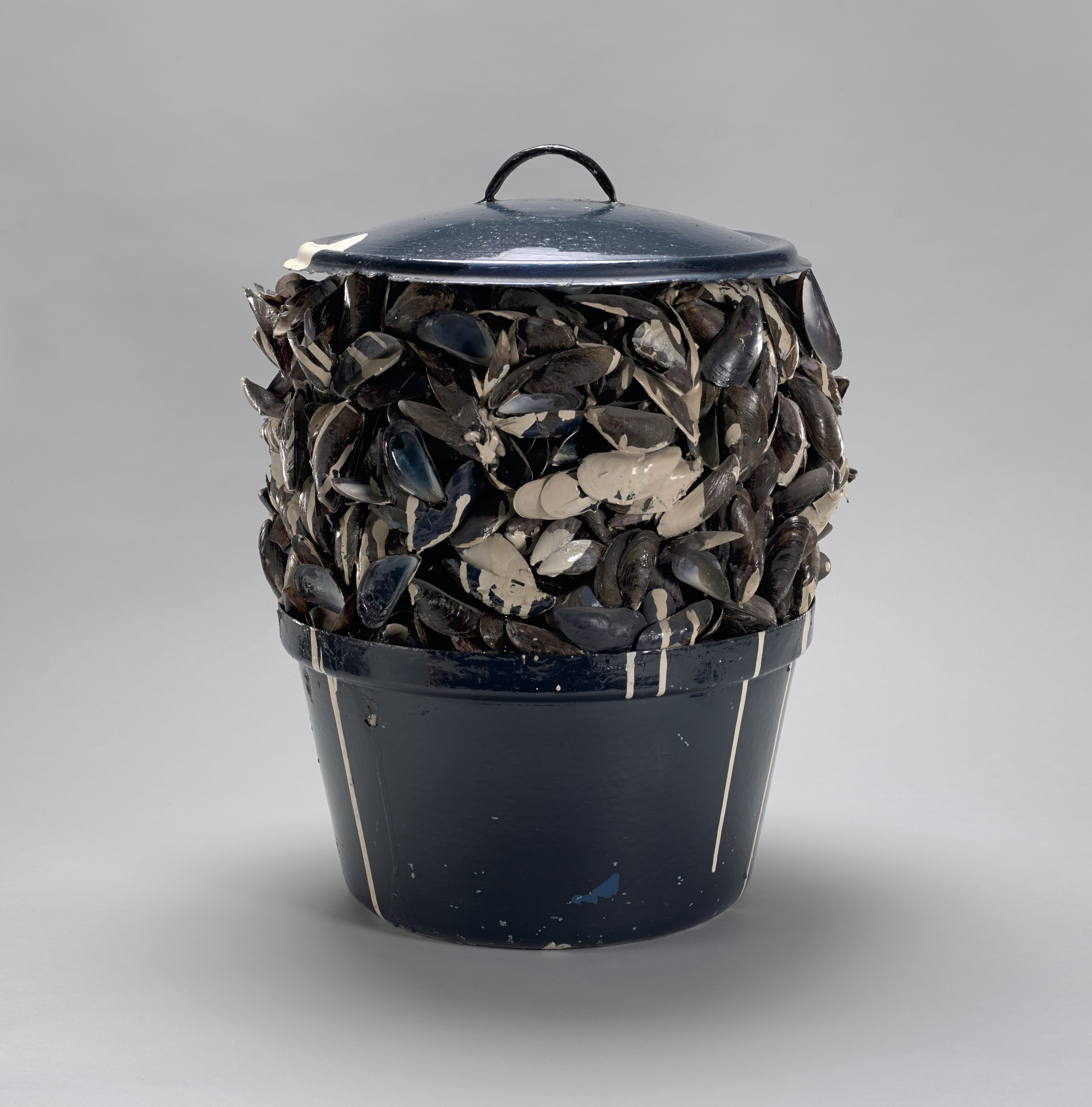 Marcel Broodthaers (Belgian, 1924–1976). Moules sauce blanche (Mussels with white sauce). 1967. Painted pot, mussel shells, paint, and tinted resin, 14 3/4 in. (37.5 cm) diam.; 19 1/8 in. (48.5 cm) high. Private collection, New York. © 2016 Estate of Marcel Broodthaers / Artists Rights Society (ARS), New York / SABAM, Brussels
