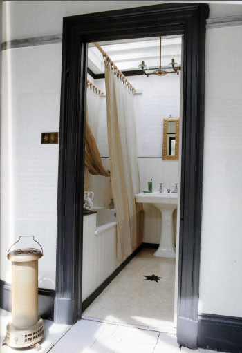 The Bathroom, with its own skylight, oval art nouveau basin and pale yellow Marmoleum floor with star insert by John-Paul.