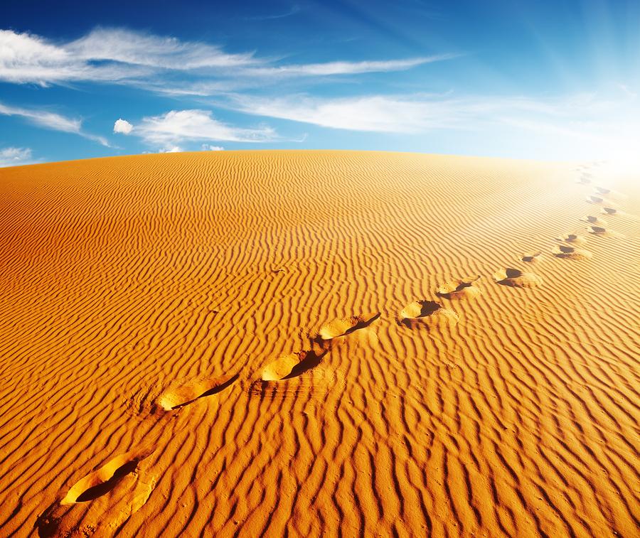bigstock-Footprints-on-sand-dune-Sahar-16402469