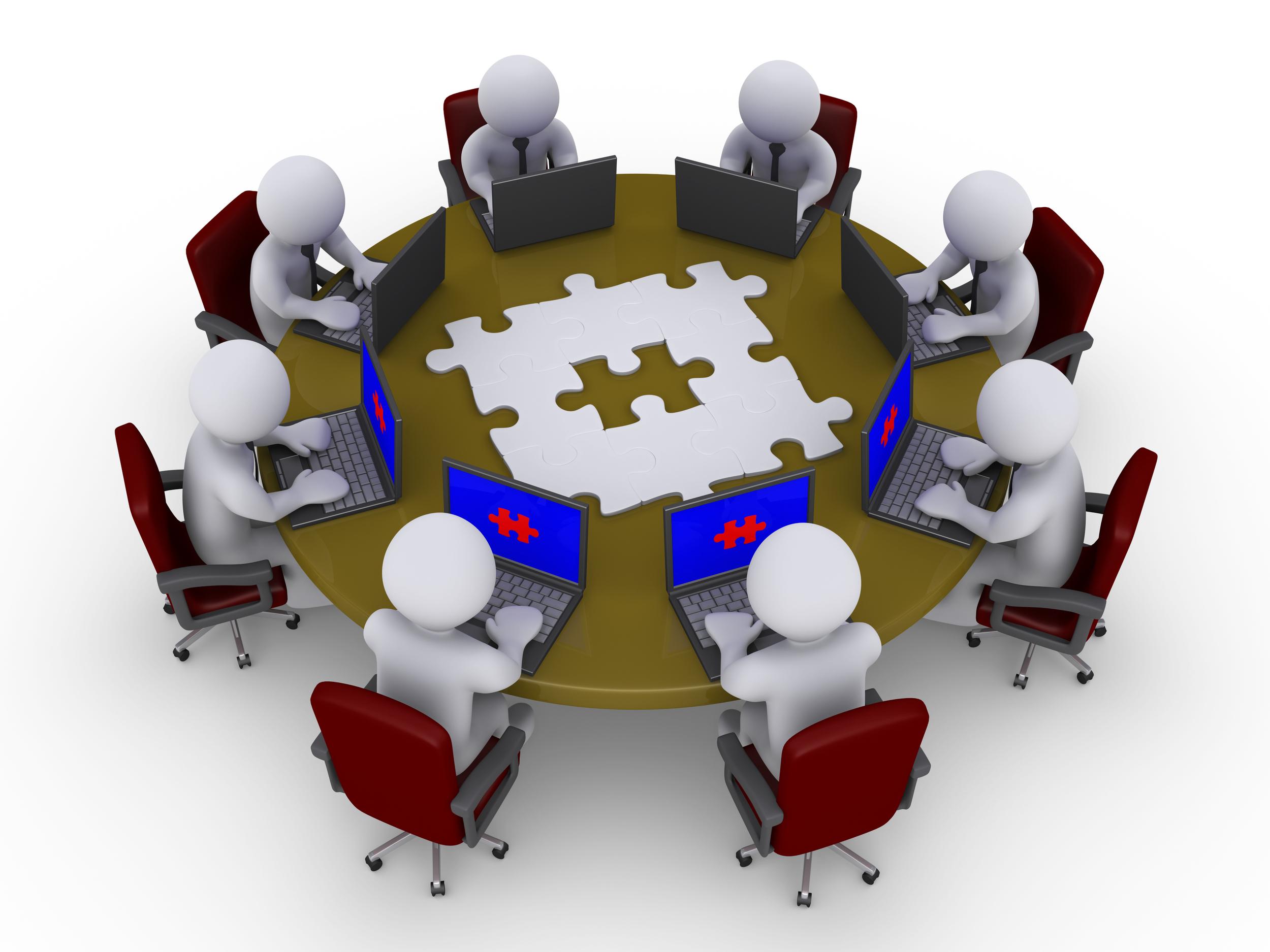 bigstock-Businessmen-Around-Table-Searc-31704239.jpg