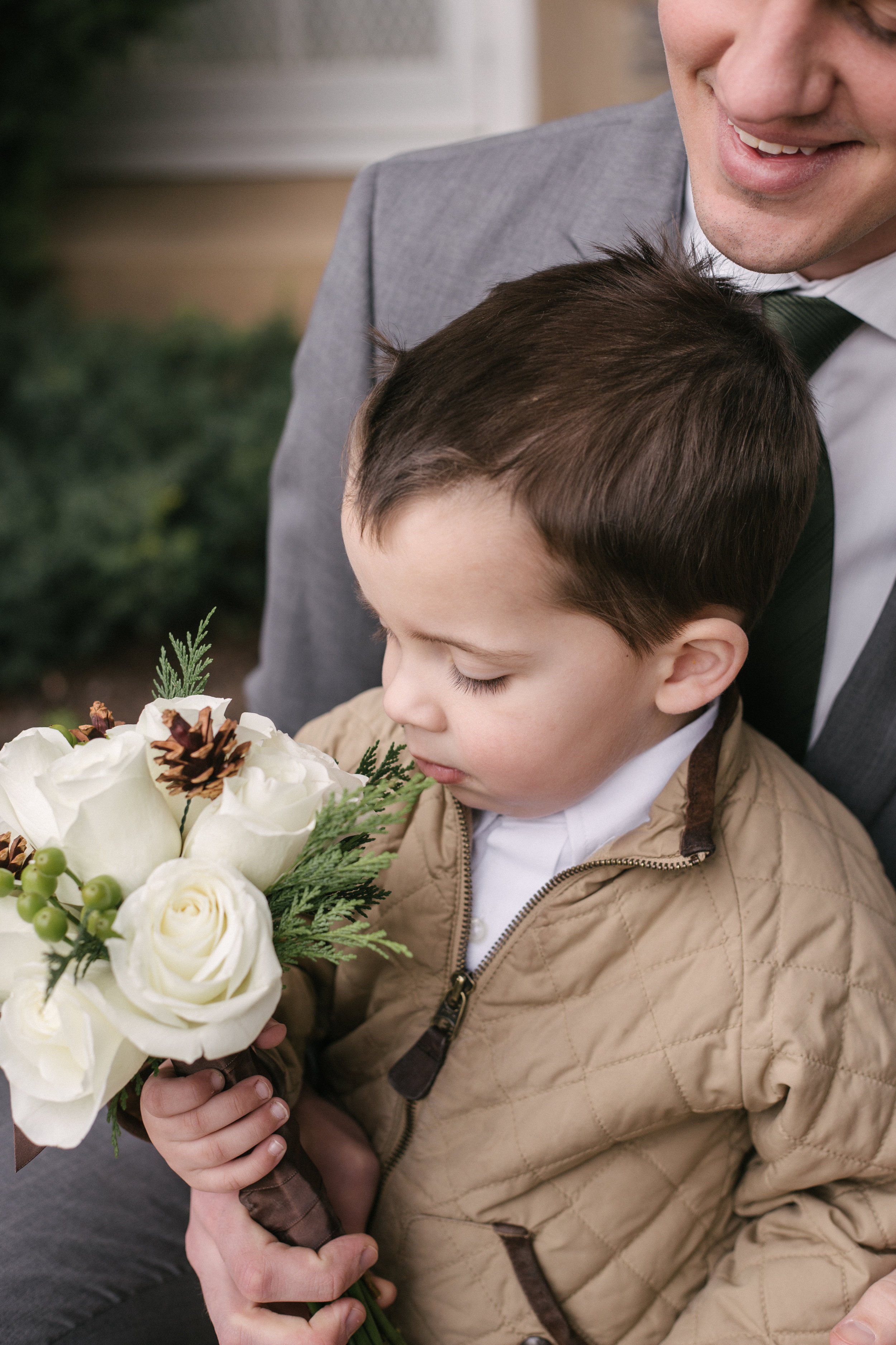 This little guy waiting outside the temple, keeping watch over the bouquet, was too cute.