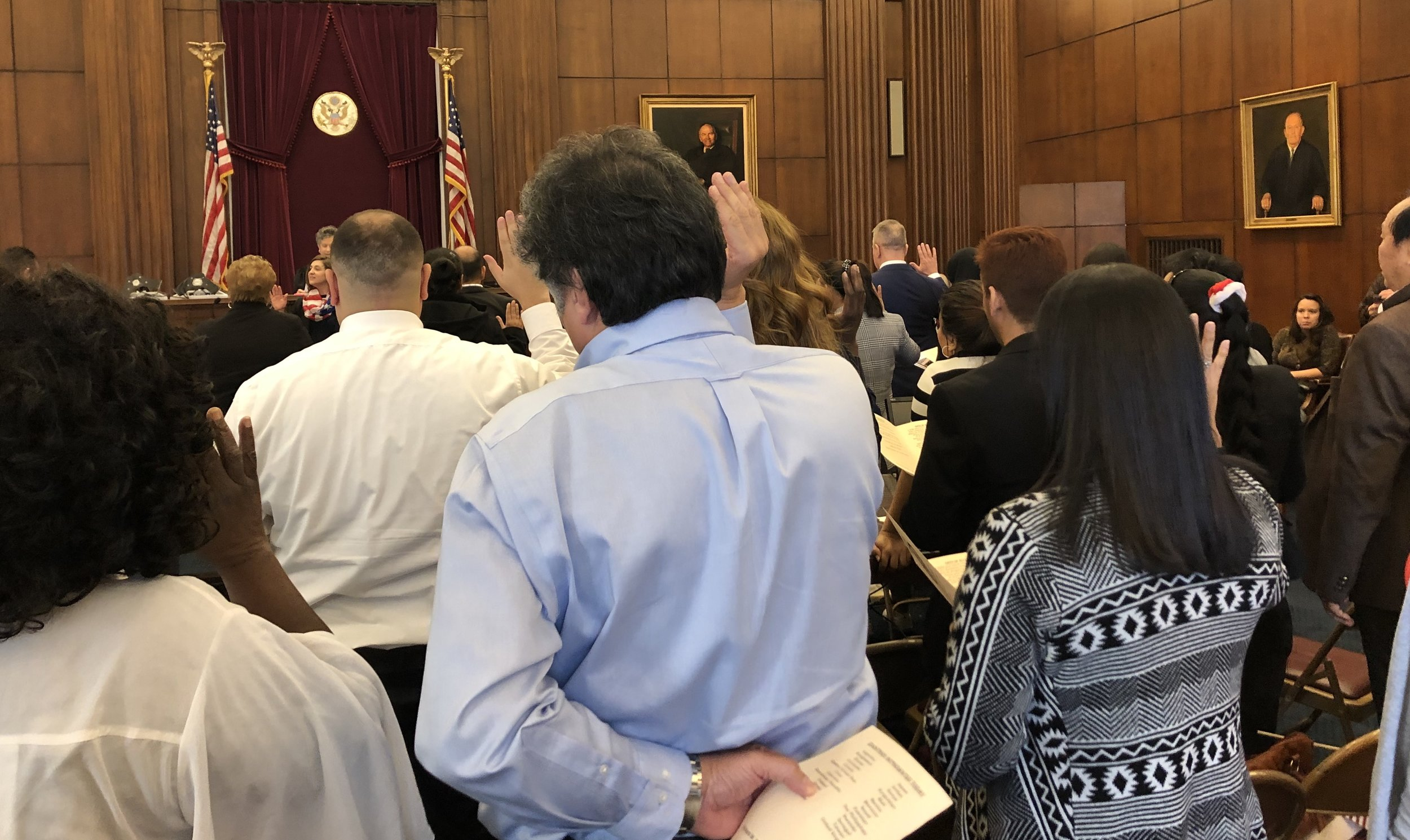 More than sixty other applicants stood to be sworn in as citizens by Magistrate Judge Karen Litkovitz at last December's ceremony in Cincinnati.