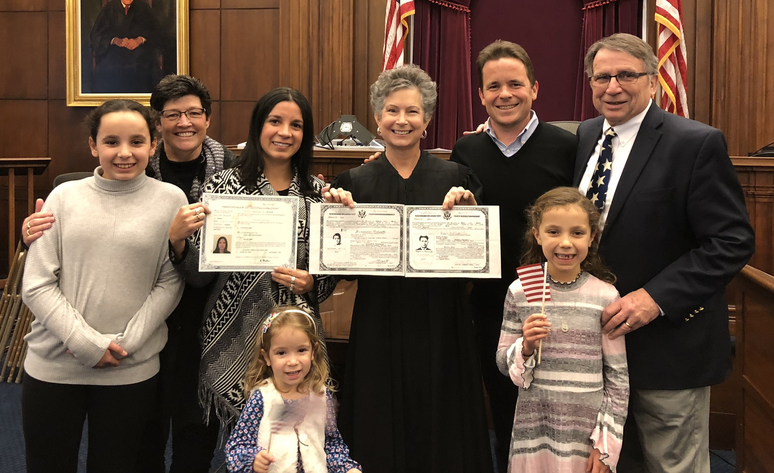 Magistrate Judge Litkovitz, next to my wife, María, and my family, shows her grandparents' Certificates of Naturalization from the 1930s and 1940s.