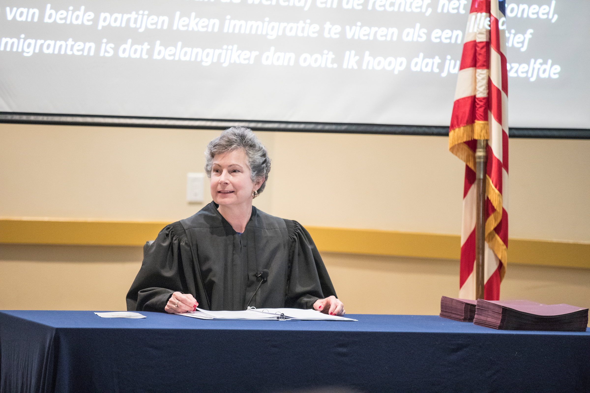 Magistrate Judge Litkovitz presides over the naturalization ceremony for students in HST 112.
