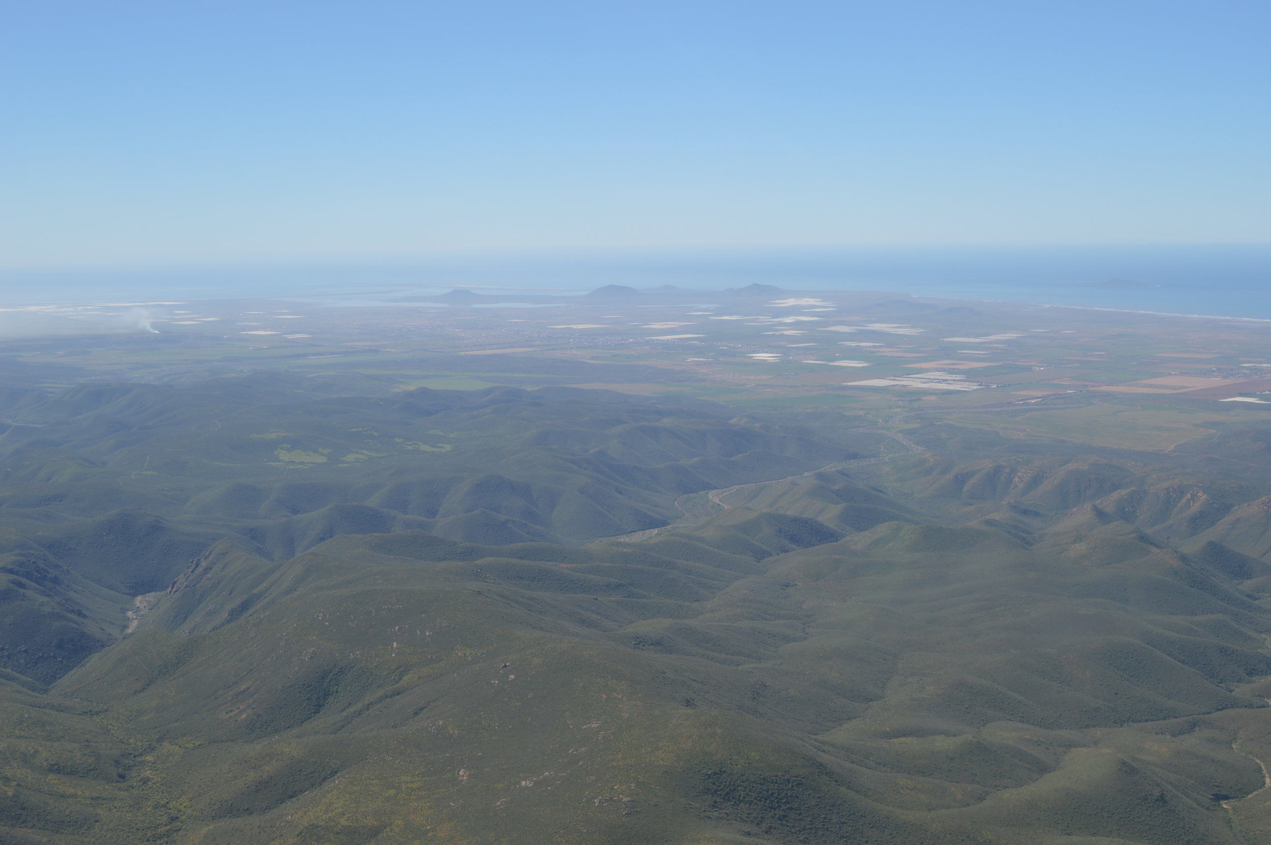 Aerial view of Sierra de San Pedro Martir Mountains, Sea of Cortez in background.