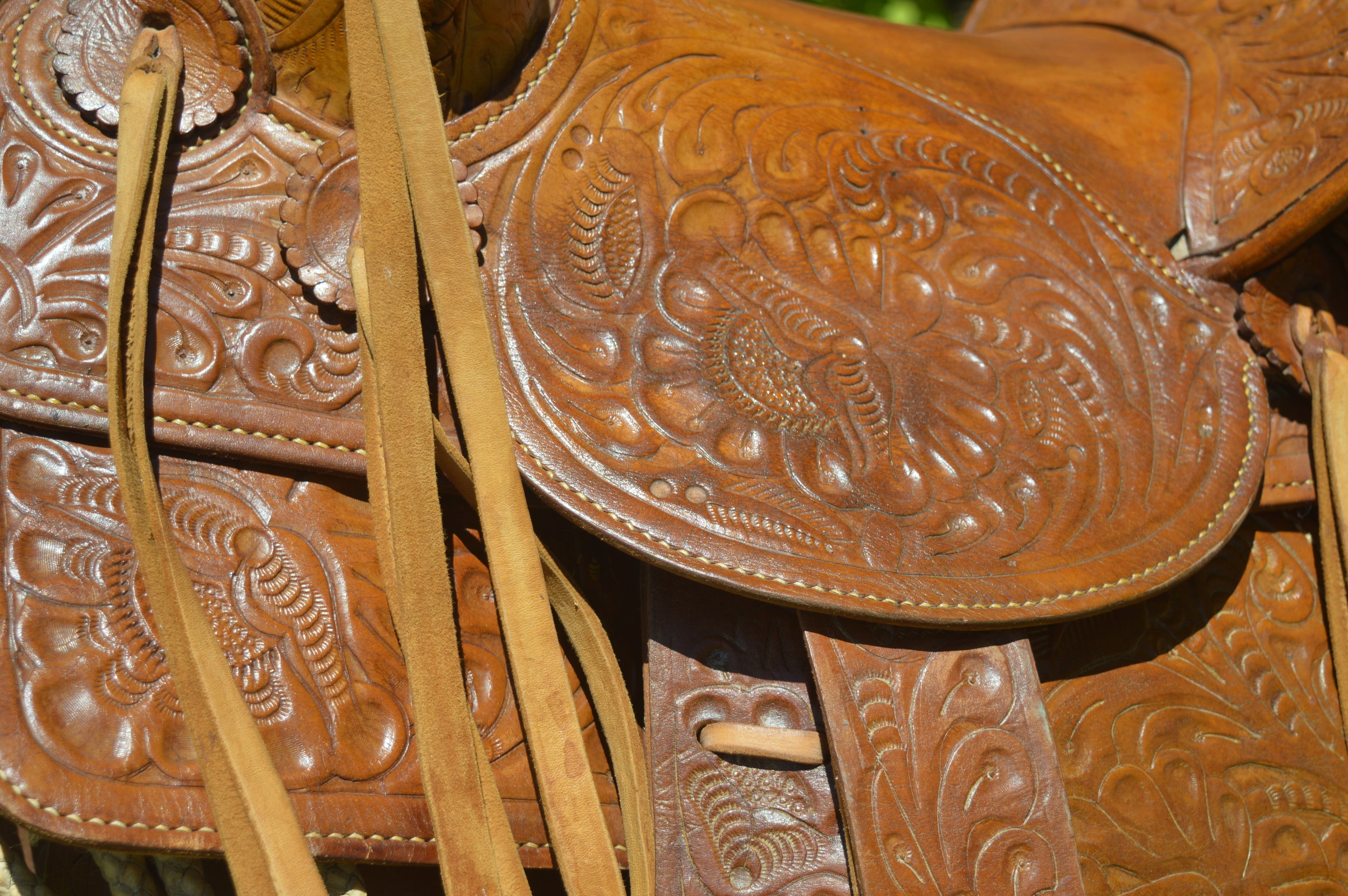 The details of Oscar's traditional, handmade leather saddle.