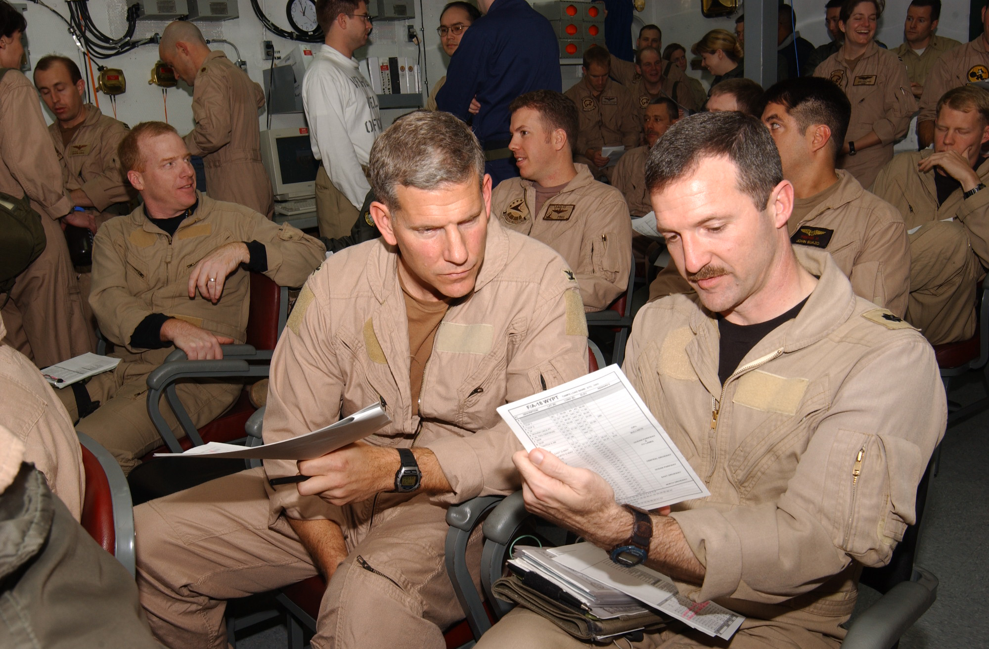 US_Navy_030323-N-5932S-007_Two_Naval_Aviators_assigned_to_Carrier_Air_Wing_Fourteen_(CVW-14)_prepare_for_a_brief_in_a_squadron_ready_room_aboard_the_aircraft_carrier_USS_Abraham_Lincoln_(CVN_72).jpg
