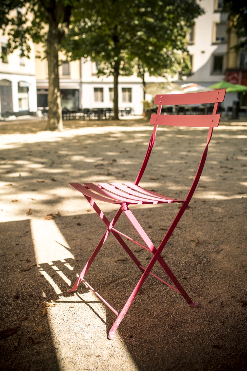 Pink chair in Geneva square