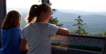The view from Great Hill Tower takes in all Tamworth, the Sandwich Range, & the Ossipee Mountains.