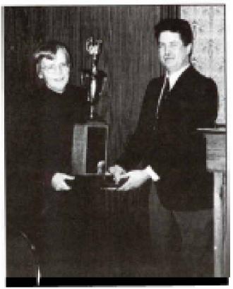 Bonnie Marschand receiving the Guimont Award from Jan Schroeder