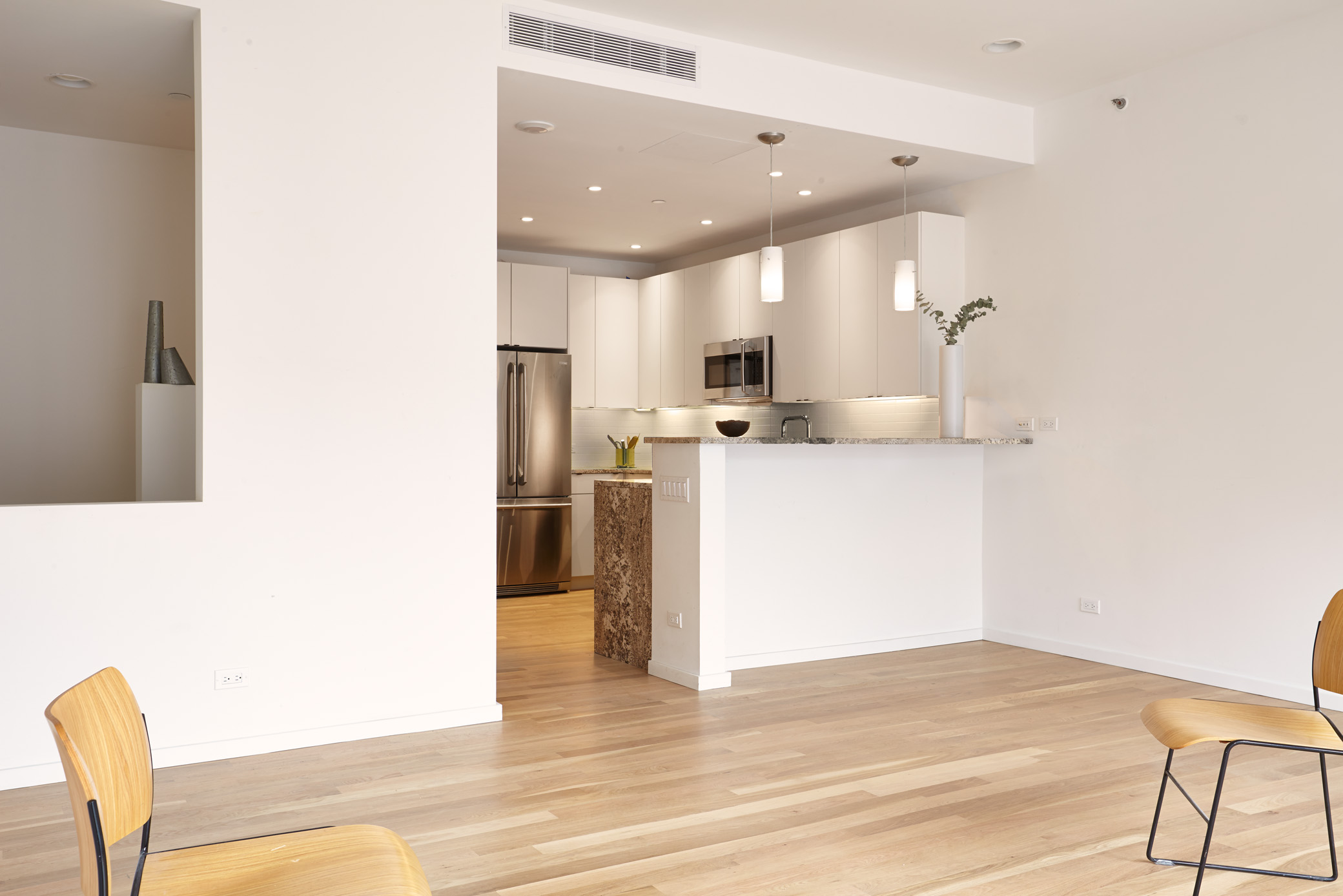 """We estimate for a high-quality, efficient project like this, there will be a five percent premium on standard costs,"" says Castrucci, who worked with Further Inc. on the project. ""It's not an extreme cost."" The kitchen includes white oak flooring, stone countertops, and Electrolux appliances."