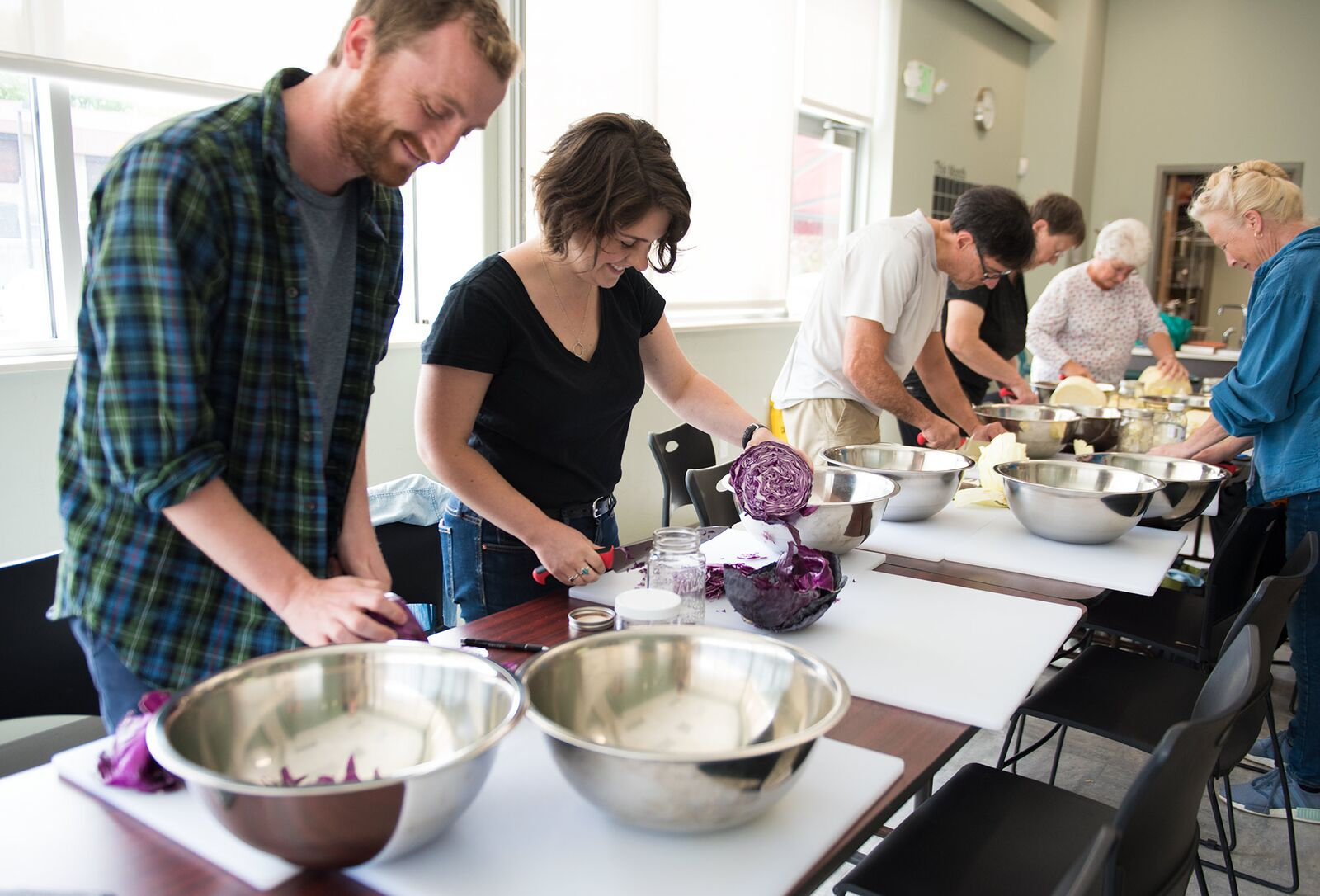 Workshop participants chop cabbage during a vegetable fermentation workshop at Honest Weight Food Cooperative in Albany, New York.