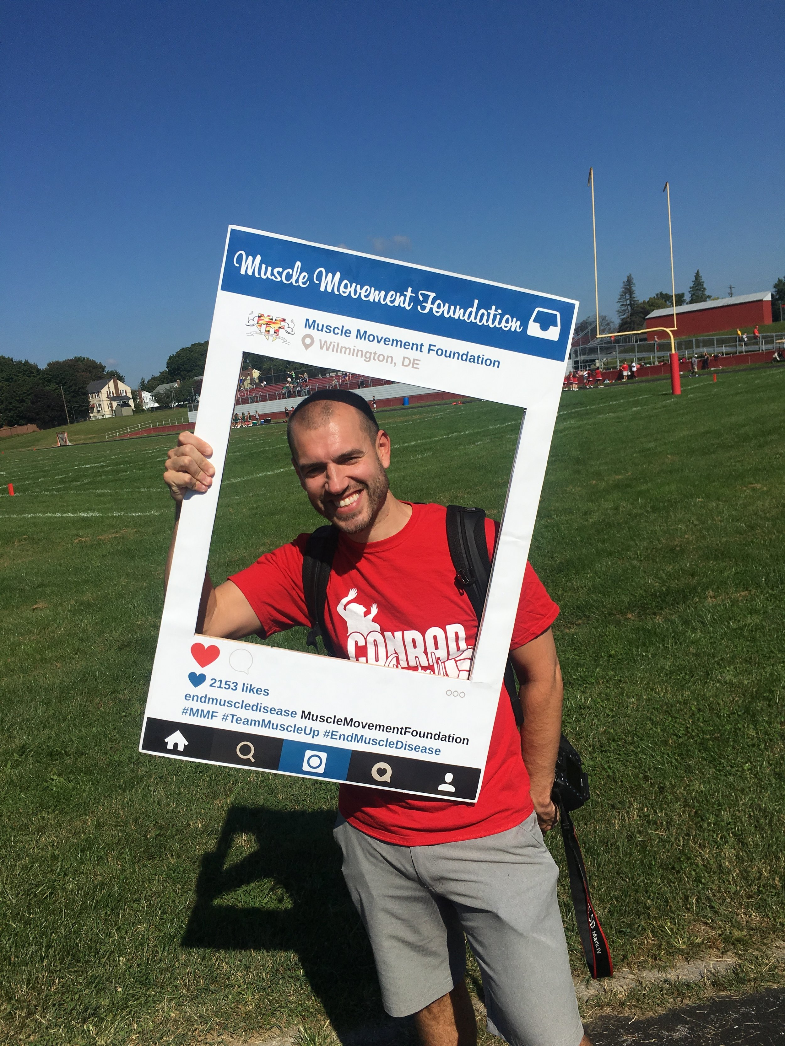 Mr. Rob Naylor poses with the Muscle Movement Foundation Instagram frame!