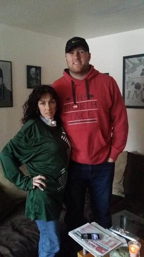 Muscle Movement Fnd. Advocate and Professional Football Player, Justin Perillo, on a home-visit with Marci in 2015. Justin surprised Marci with authentic and signed memorabilia. Marci wore this apparel all season!