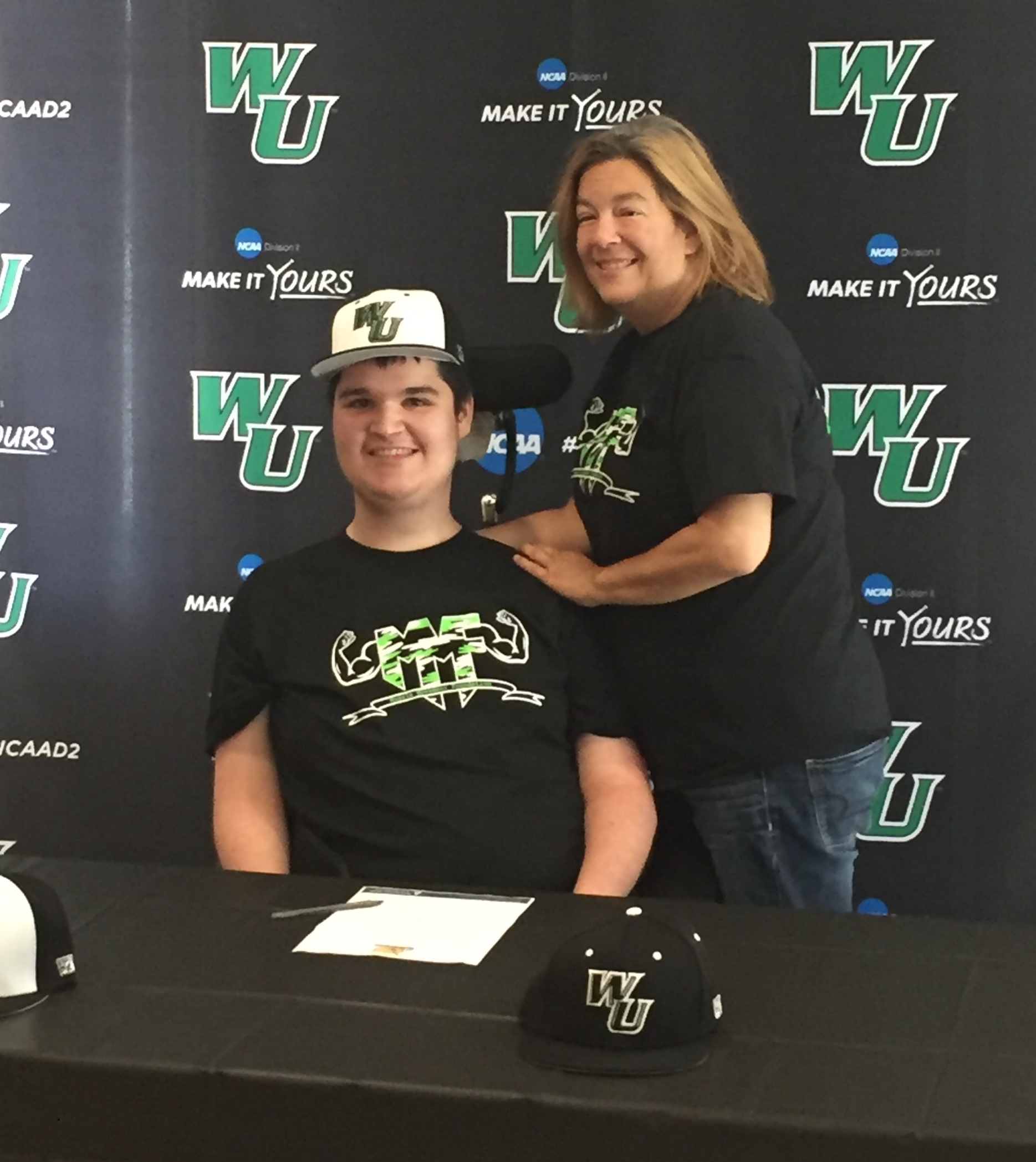 Mike Smith and mother, Jackie Smith, proudly pose for a picture during the 2018 Wilmington University Baseball Team's signing day! Mike signed a 2018 Letter of Participation, by way of the Muscle Movement Fnd.!