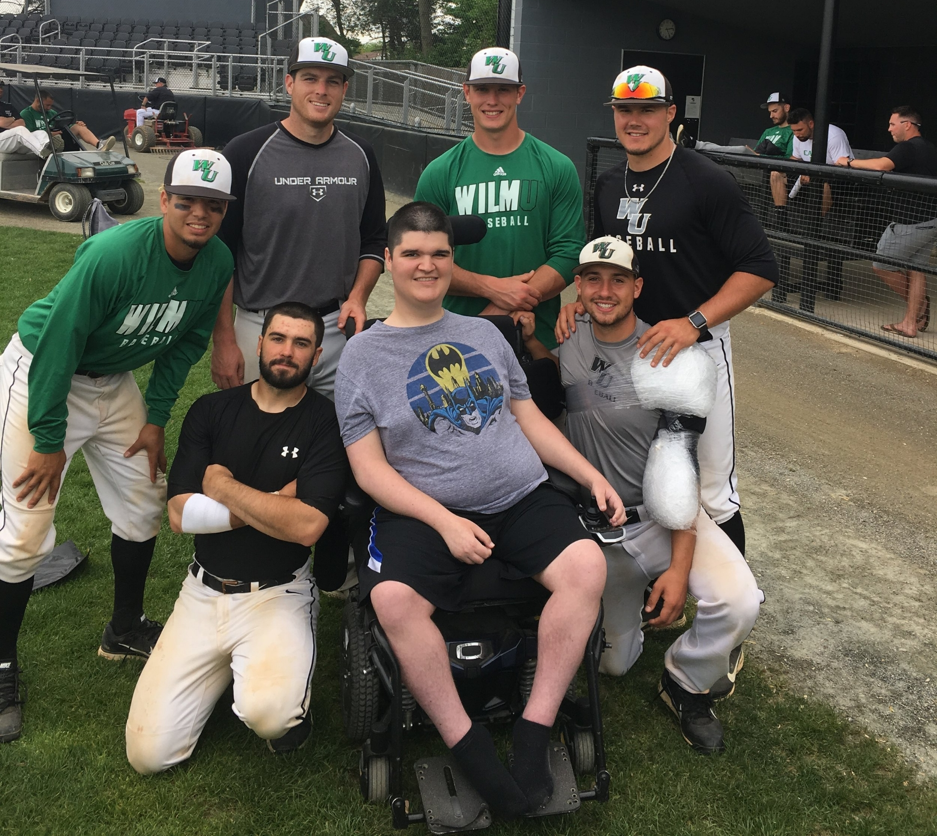 Muscle Champion, Mike Smith, and the WilmU Baseball Team celebrate as they advance to the 2018 CACC Tournament!