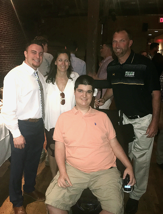 MMF President, Rob DeMasi (left), Wilmington University Director of Athletics, Dr. Stefanie Whitby, Head Baseball Coach, Brian August (right), and Muscle Champion, Mike Smith!