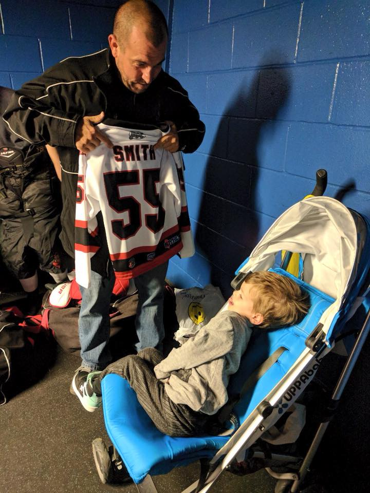 Head Coach Scott Harrington presents Muscle Movement Fnd. Muscle Champion, Harry Smith, his very own Jersey Shore Wildcats hockey jersey! #55!