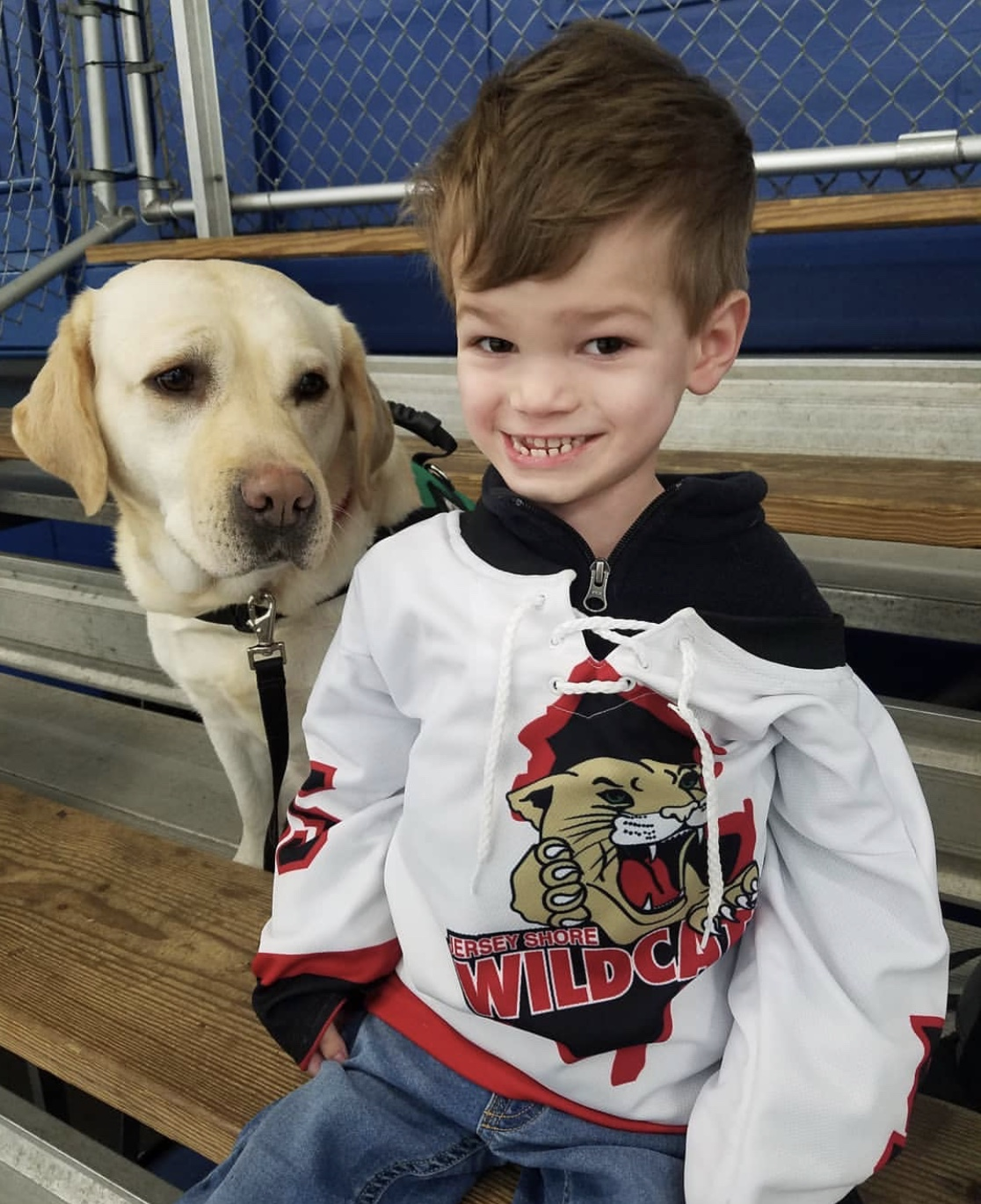 Harry enjoys a NJ Wildcats game with Queenie by his side!