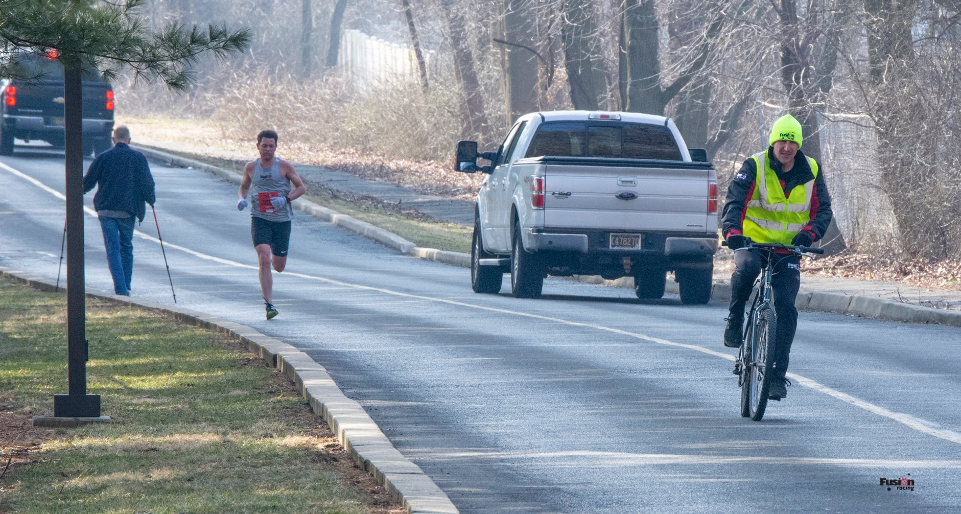 Michael DiGennaro (middle) leads the race participants and strides towards a record-breaking finish.