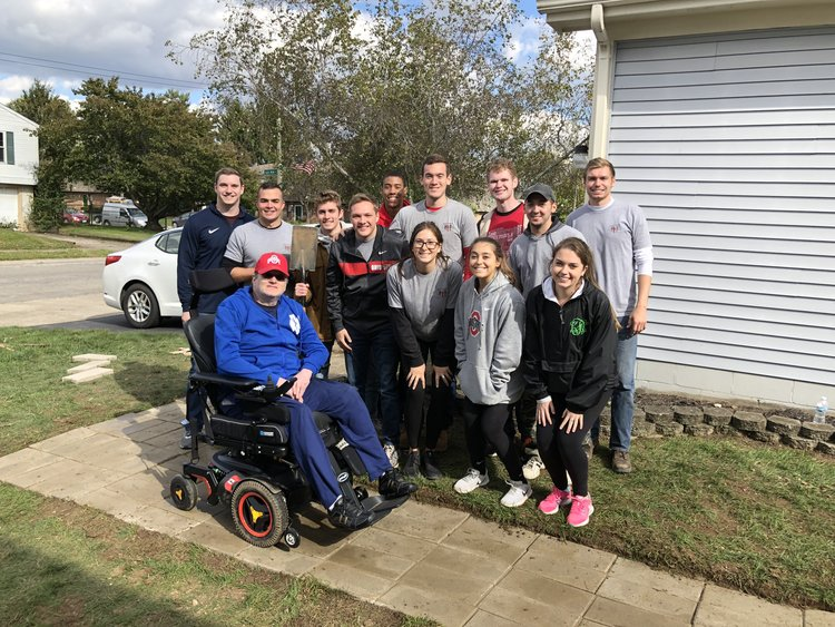 Students at Ohio State University completed a wheelchair accessible path for a local MMF Muscle Champion in need!