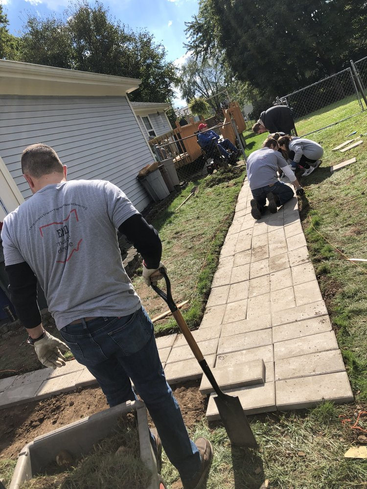 Students at Ohio State University construct a wheelchair ramp for a local MMF Muscle Champion.