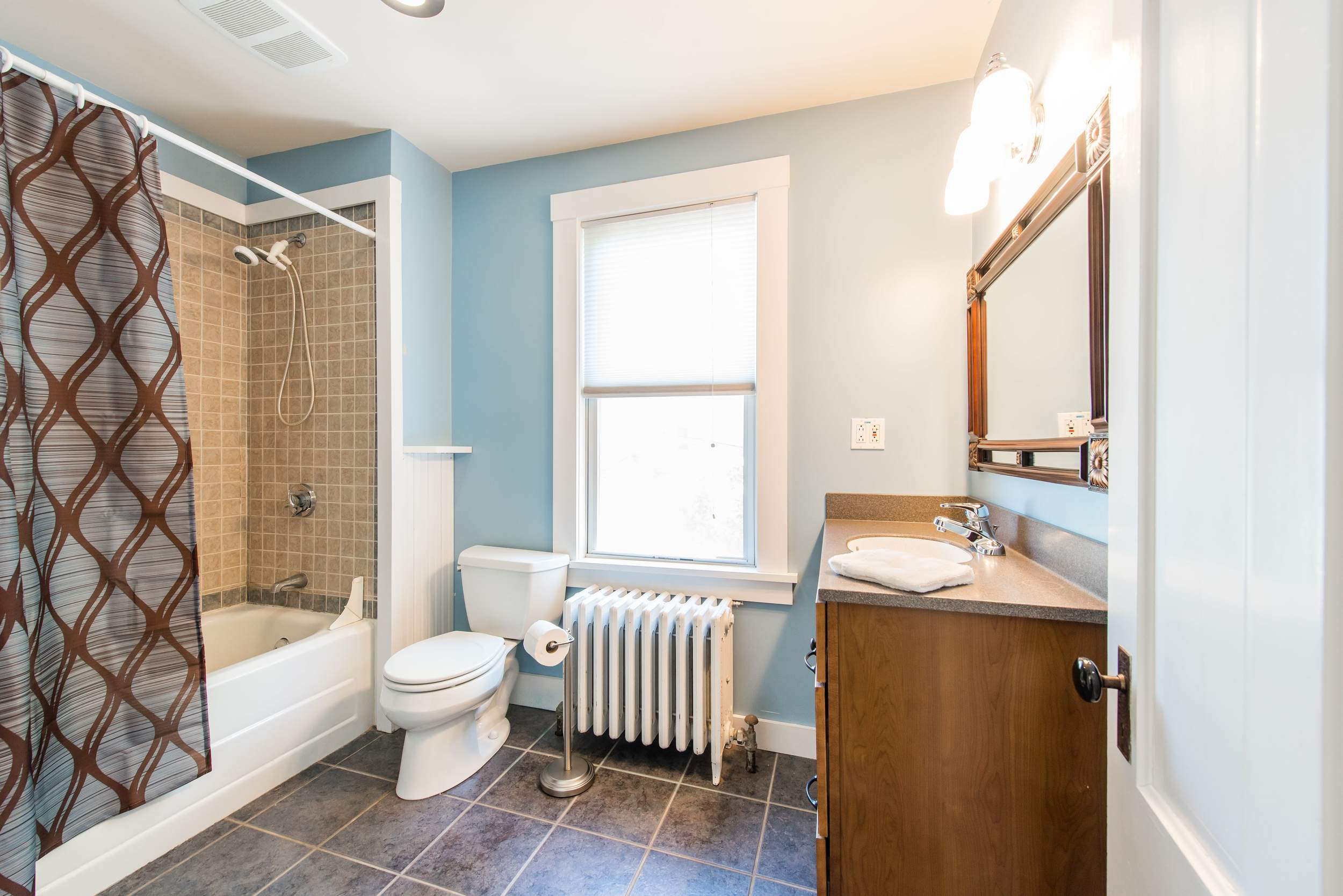 Upstairs bathroom with shower/tub.