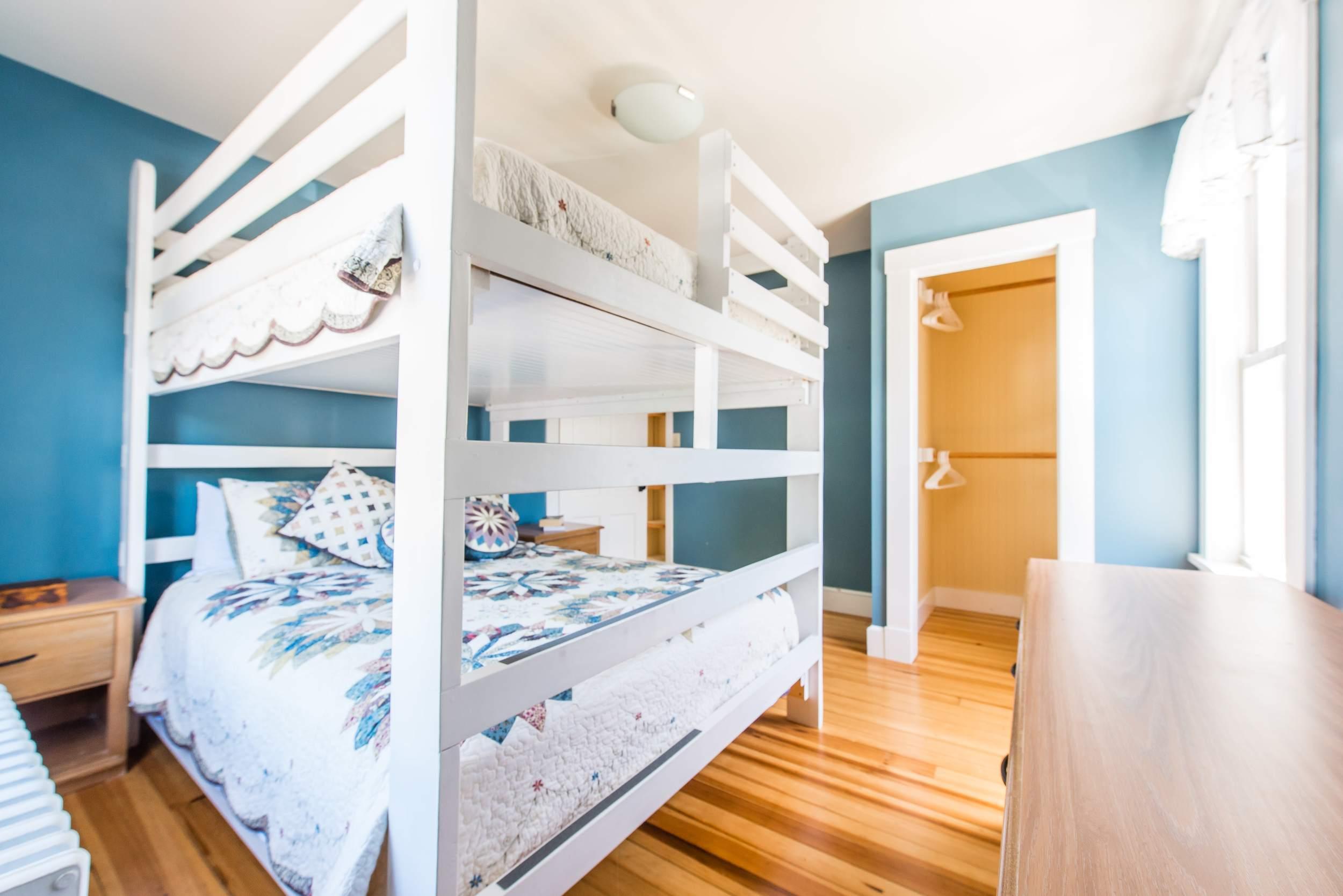 Bedroom with custom made queen over queen bunk bed.