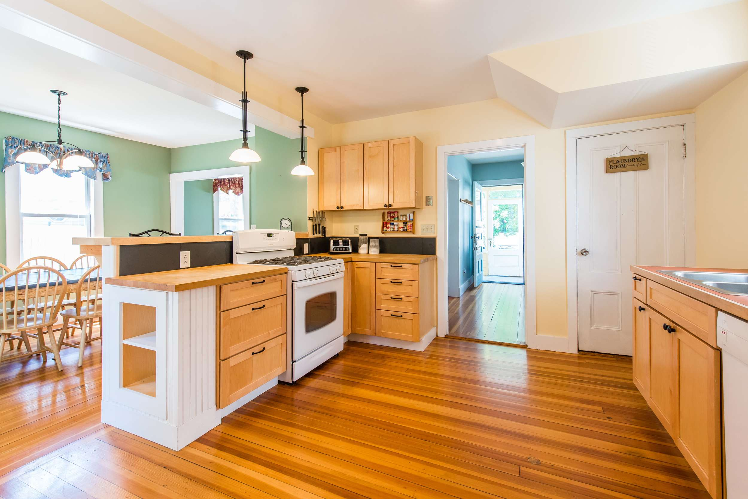 Large fully equipped kitchen with gas stove/oven.