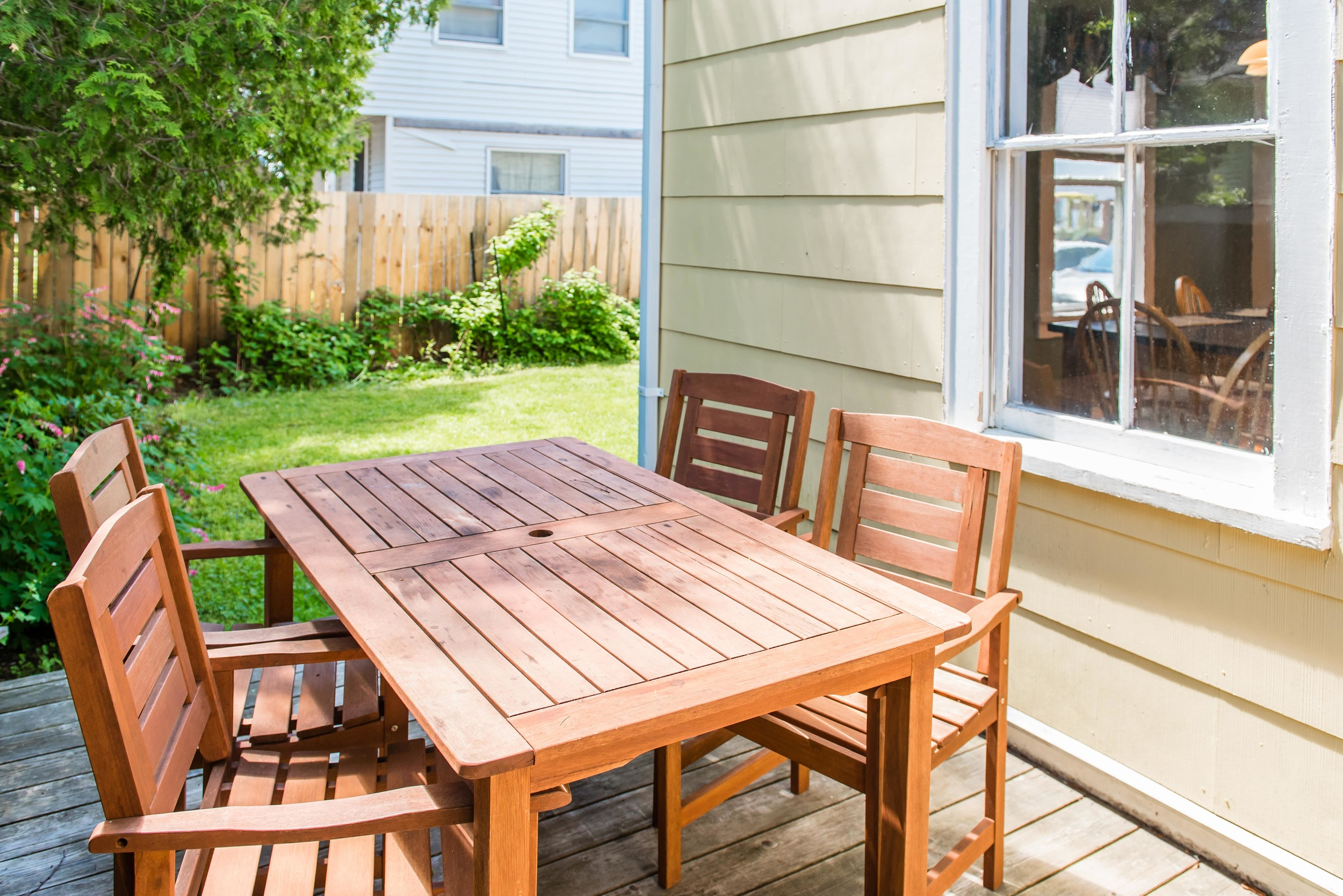 Back deck with dining area and grill.