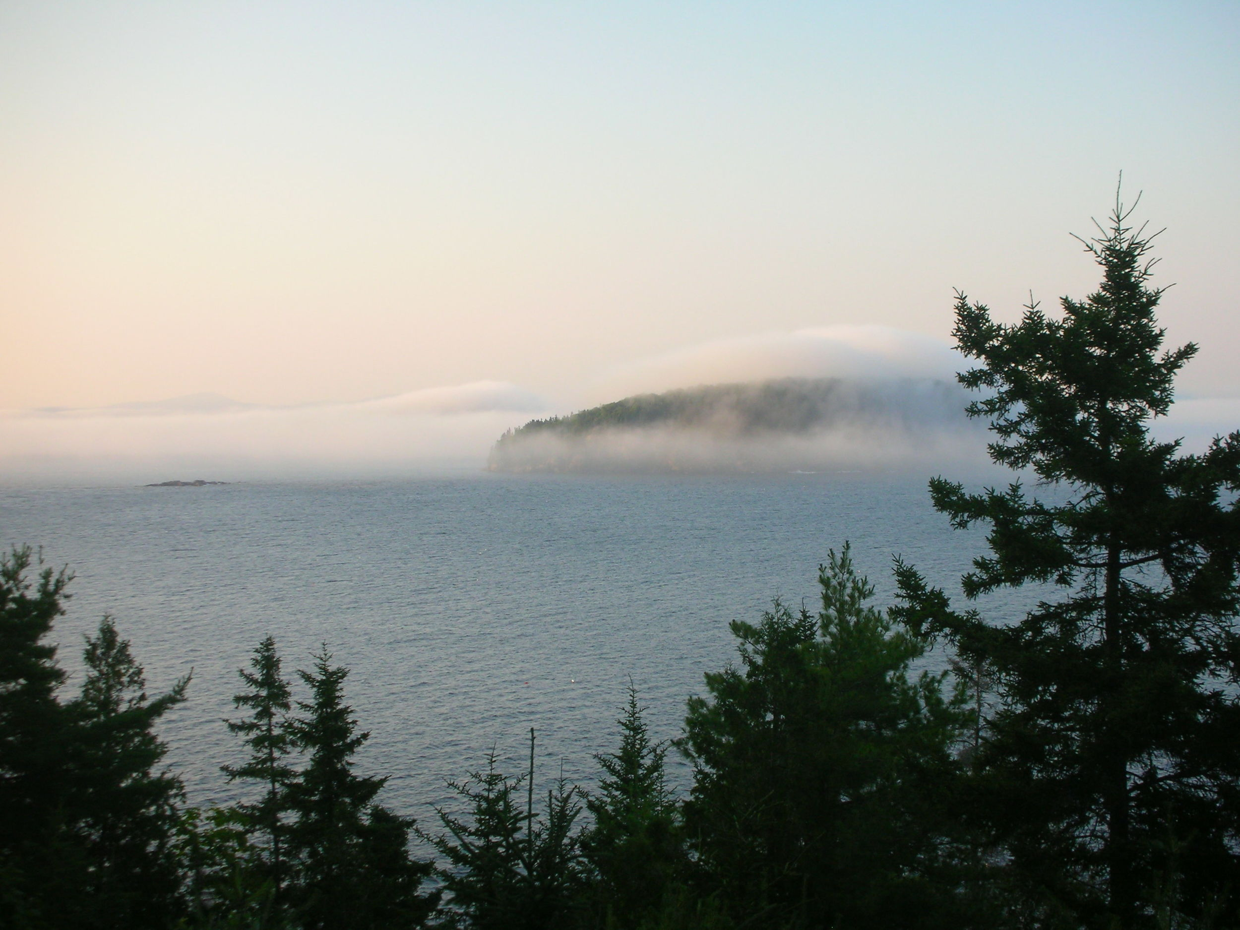 The fog's artistic brush stroke over the Porcupine Islands from the porch.