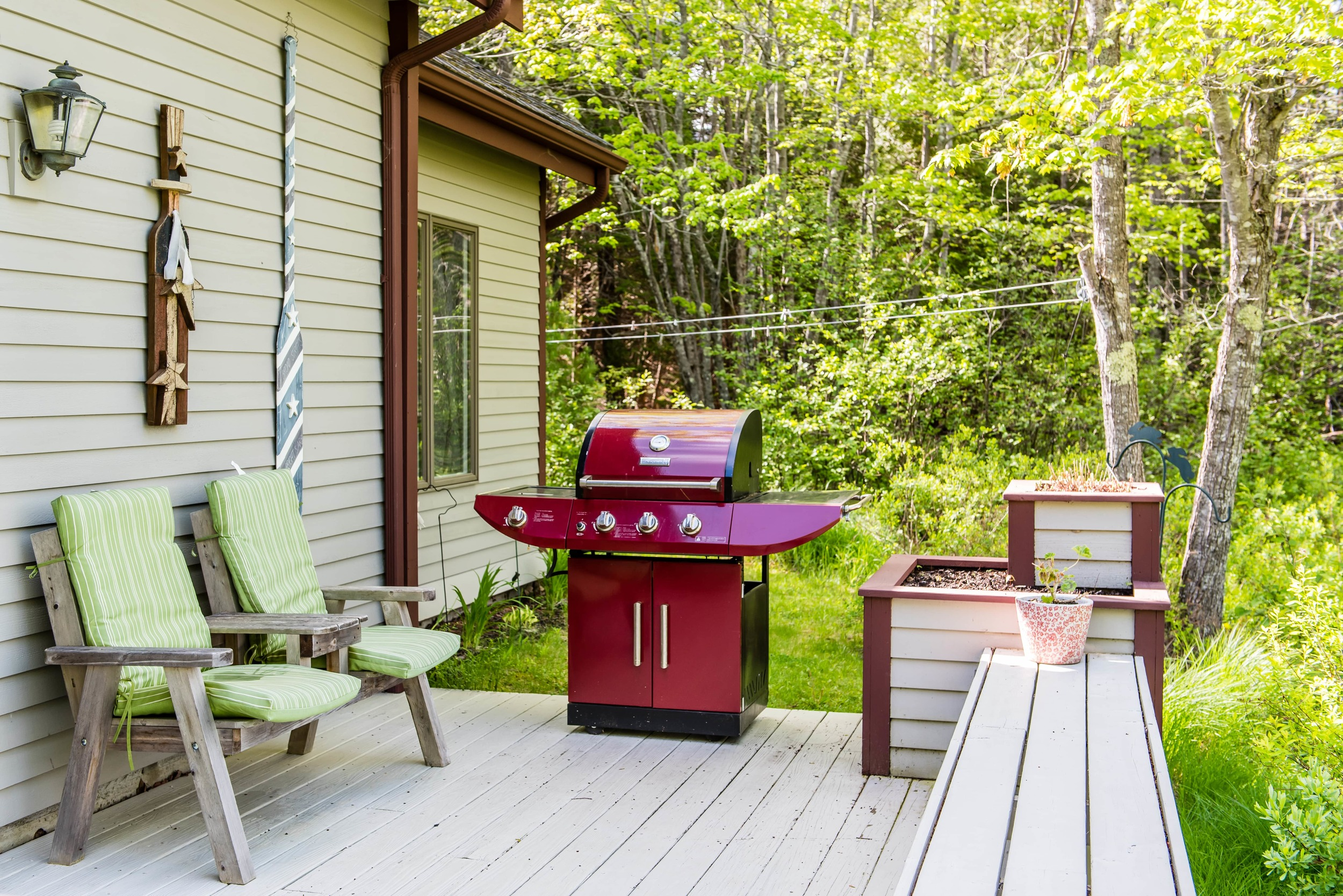 The large deck has a grill, picnic table and ample additional seating.