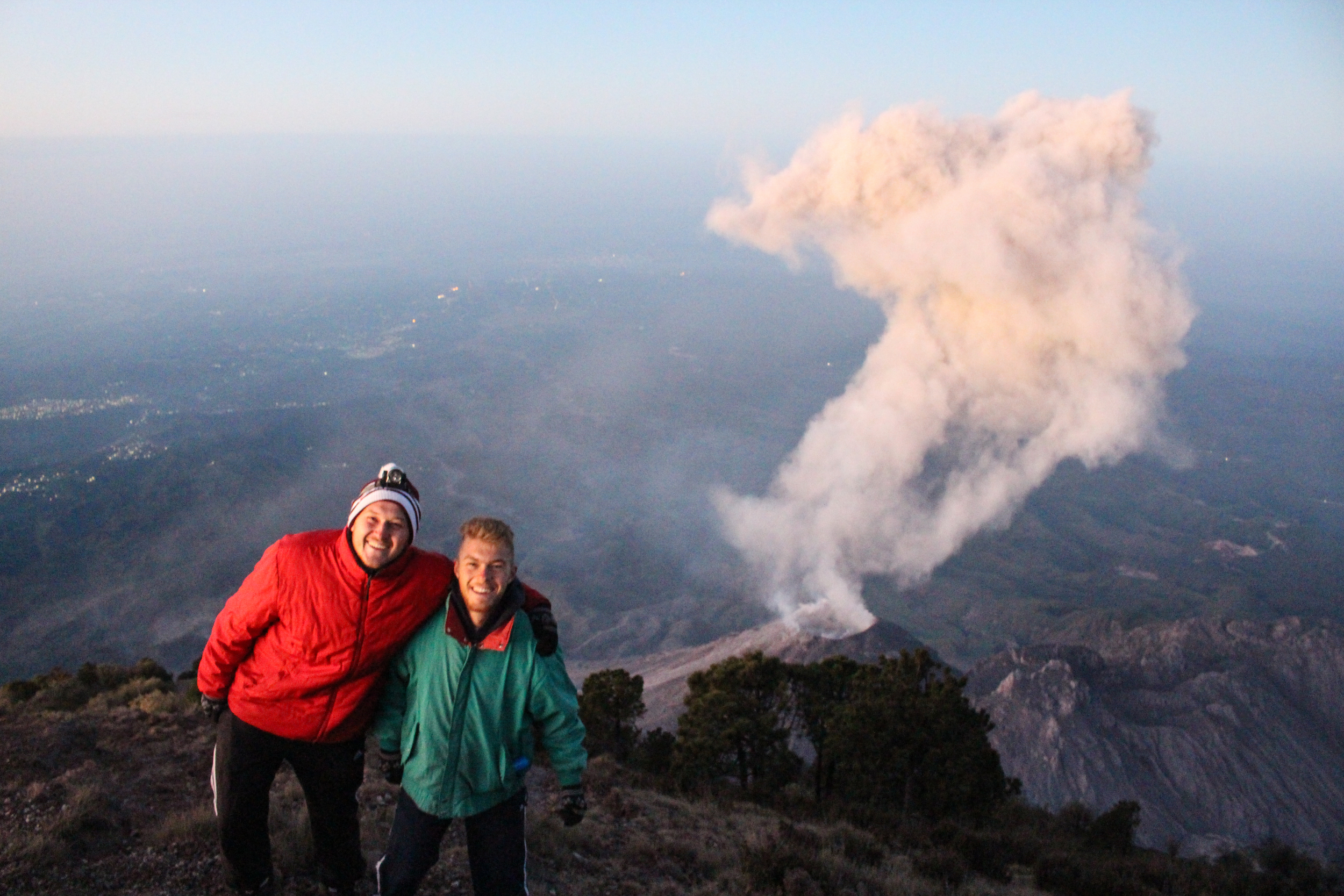 Two happy hikers witnessing the eruption of Santiaguito