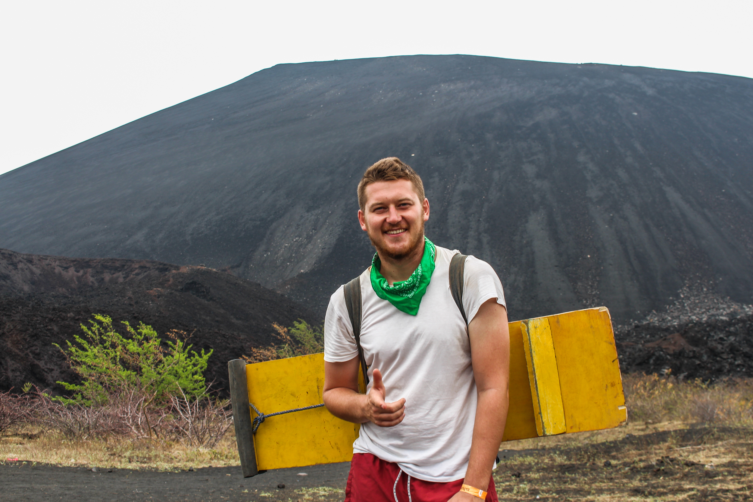 A British volcano boarder stands at the foot of Cerro Negro