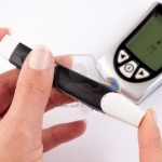 7519846-woman-pricking-her-finger-for-a-blood-test-with-a-glucometer-in-the-background-150x150.jpg