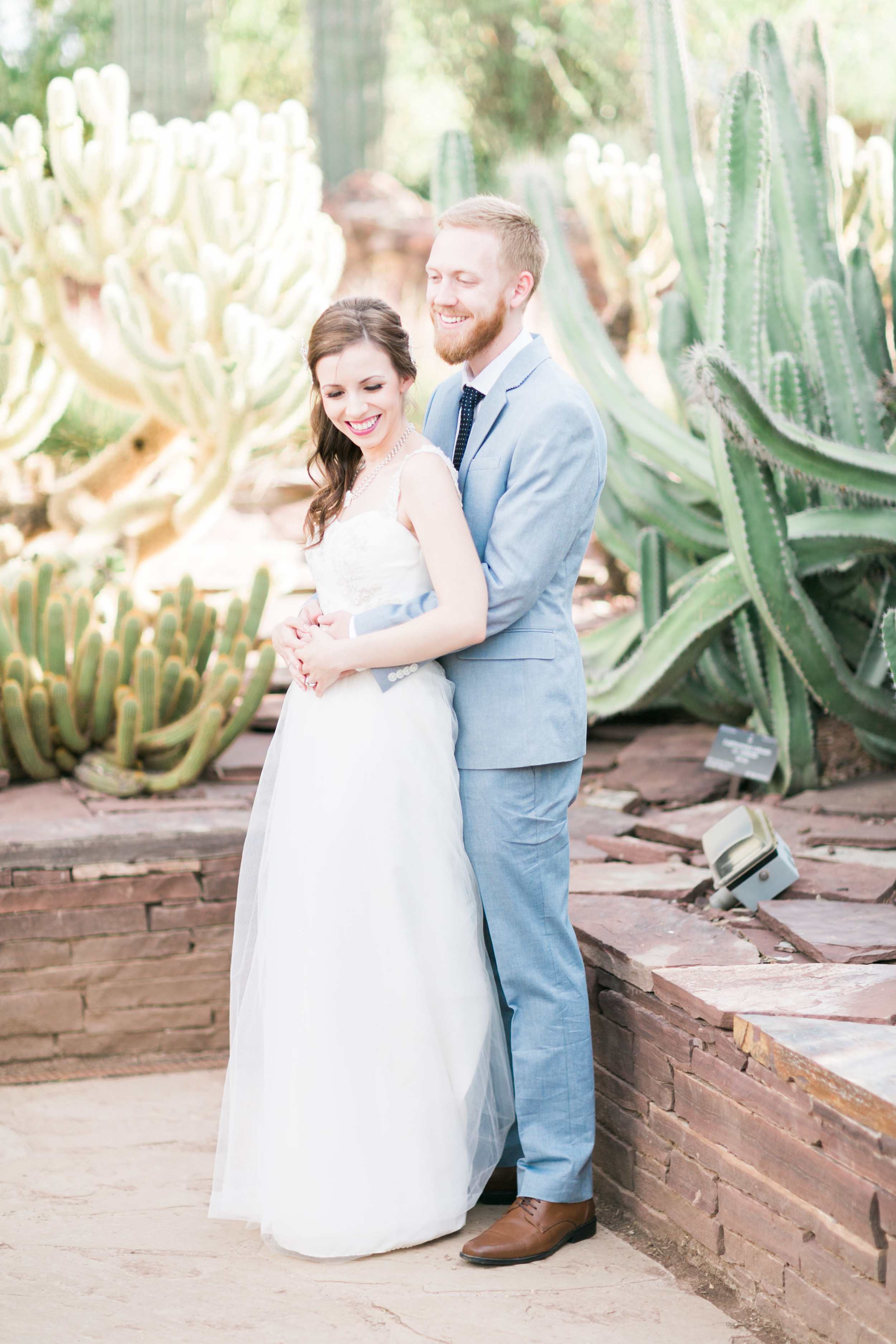 Embracing in the cactus garden
